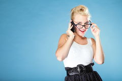 Retro style. Happy girl talking phone Stock Photos