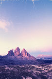 Retro style image of Tre Cime at sunrise Royalty Free Stock Photography