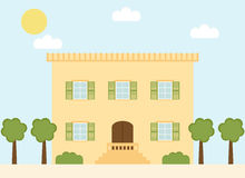 Retro style italian village house with window shutters and trees. Royalty Free Stock Images