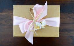 Retro style kraft paper gift. Royalty Free Stock Photo