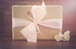 Retro style kraft paper gift. Royalty Free Stock Photography