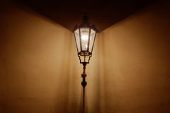 Retro style lantern illuminating wall Stock Photos