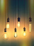 Retro style light bulbs. Illuminated retro style light bulbs. Trendy design Stock Photography