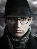 Retro style male portrait. Closeup portrait of a serious young man in the black hat looking at camera Stock Photo
