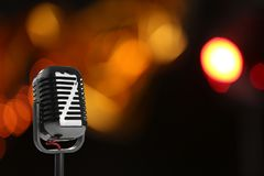 Retro style microphone against blurred background. Space for text royalty free stock photo