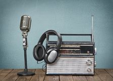 Retro style microphone, old radio  and headphones. Style retro mic microphone headphones background holiday Royalty Free Stock Images