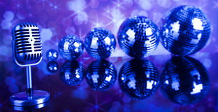 Retro style microphone on sound waves and Disco Balls Stock Photography