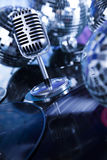 Retro style microphone on sound waves and Disco Balls Royalty Free Stock Images