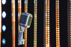 Retro style microphone on stage in the spotlight performance of the musical group. Stock Image
