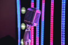 Retro style microphone on stage in the spotlight performance of the musical group. Stock Images