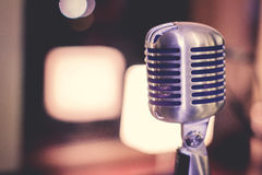Retro style microphone on stage in the spotlight Royalty Free Stock Photos