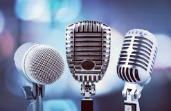 Retro style microphones on  background. Style retro mic microphones background holiday equipment Royalty Free Stock Images