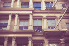 Retro style New York City Apartment Building. Vintage toned image New York City view of exterior facade on ornate old apartment building residence seen from stock image