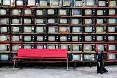 Retro style old television from 1950, 1960 and 1970s.With Red bench and black dog is looking camera. Vintage tone instagram style filter photo stock photos