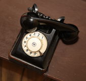 Retro style. old vintage black telephone disk apparat Stock Photography