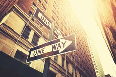 Retro style one way signs on street of Manhattan. Stock Image