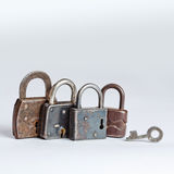 Retro style padlocks. metal textures and pattern. one opened, three closed. Stock Images