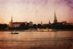 Retro style panorama of old Riga at dusk Royalty Free Stock Photos