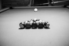 Retro style photo from a billiards balls, Noise added for real. Film effect,8ball Rack,Black and white poster large room with pool tables Royalty Free Stock Images