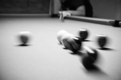 Retro style photo from a billiards balls, Noise added for real. Film effect,8ball Rack,Black and white poster large room with pool tables Royalty Free Stock Photography