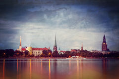 Retro style photo of night Riga cityscape Royalty Free Stock Image