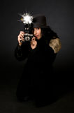 Retro Style Photographer. Retro style female photographer with vintage camera and flash Stock Photography