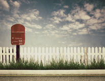 Retro style picture of postbox. At roadside Stock Photos