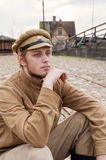 Retro style picture with resting soldier. Royalty Free Stock Photo