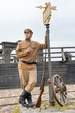 Retro style picture with soldier at tram stop. Stock Photography