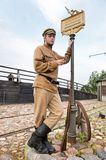 Retro style picture with soldier at tram stop. Stock Images
