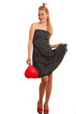 Retro style pin up girl with blonde hair in black dress wtih whi Stock Photography