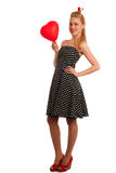 Retro style pin up girl with blonde hair in black dress wtih whi Stock Photos