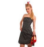 Retro style pin up girl with blonde hair in black dress wtih whi Royalty Free Stock Photography