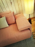 Retro style pink sofa and lamp Royalty Free Stock Images