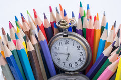 Retro style pocket watch and color pencils. Retro style classic pocket watch and color pencils on white background Stock Photos
