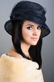Retro style portrait of beautiful woman in hat Royalty Free Stock Image