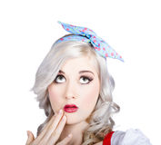 Retro style portrait of a blond girl with a bow Stock Image