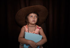 Retro style portrait of girl in straw hat Royalty Free Stock Photography