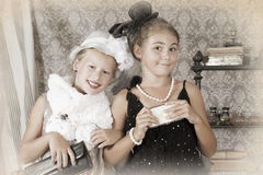 Retro style portrait of two little girls Stock Image
