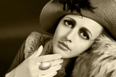 Retro style portrait of a young woman in hat Royalty Free Stock Photography