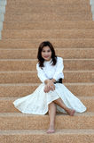 Retro style of pretty asian woman on stairs . Stock Photography