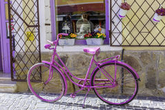 Retro style purple bicycle near the store. Retro style purple bicycle near the souvenir shop Royalty Free Stock Images