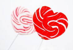 Retro style red , pink heart shape lollipop Stock Photography
