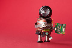 Retro style robot character with chip board. Computer accessories toy mechanism, funny black helmet head on red background. Copy s Stock Photo