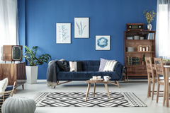 Retro style room. Retro style cozy living room with blue walls and white floor Stock Images
