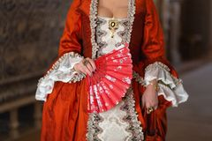 Retro style royal medieval ball - Majestic palace with gorgeous people dressed in king and queen`s friends dresses with royalty free stock image