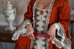 Retro style royal medieval ball - Majestic palace with gorgeous people dressed in king and queen`s friends dresses with stock photo