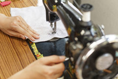 Retro style sewing machine working Royalty Free Stock Photo