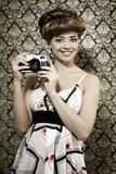 Retro style. Smiling girl with camera royalty free stock photography