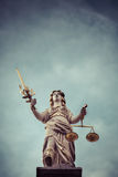 Retro style statue of Lady Justice Royalty Free Stock Photo
